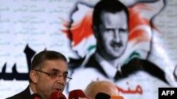 Сириянын элдешүү боюнча министри Али Хайдар өлкөнүн биримдигине арналган жыйында сүйлөөдө. Дамаск, 16-январь 2014