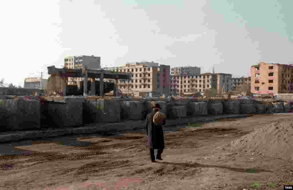 A man walks among the ruins of Grozny in 1997. Part of the peace agreement held that the status of Chechnya would be determined in 2001. But as Chechnya entered a lawless and violent period following the cessation of the war, it would turn out that peace with Russia was only temporary. Two years after this picture was taken, a second brutal war was launched that would ultimately bring Chechnya back under Russian control. The man who drove the second Chechen war would become Russia's new president, Vladimir Putin.