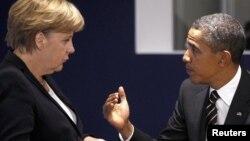 АҚШ президенті Барак Обама (оң жақта) мен Германия канцлері Ангела Меркель. 4 қараша 2011 жыл.