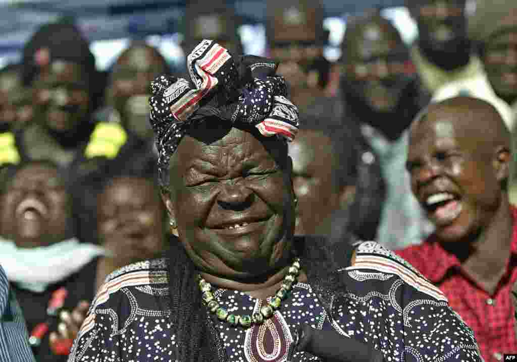 Sarah Obama, stepgrandmother to U.S. President Barack Obama, reacts to news of his reelection victory in the hamlet of Kogelo in western Kenya. (AFP/Tony Karumba)