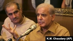 FILE: Shahbaz Sharif (R), leader of the opposition, also heads the Pakistan Muslim League, addresses a news conference in Lahore in July.