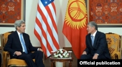 Kerry (left) holds talks in Bishkek with President Almazbek Atamabev