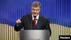 Ukrainian President Petro Poroshenko speaks during a news conference in Kyiv on January 14.