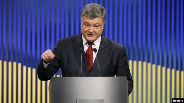 Ukrainian President Petro Poroshenko speaks during a news conference in Kyiv on January 14.