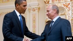 U.S. President Barack Obama and Russian Prime Minister -- and now president-elect -- Vladimir Putin during a meeting near Moscow in July 2009