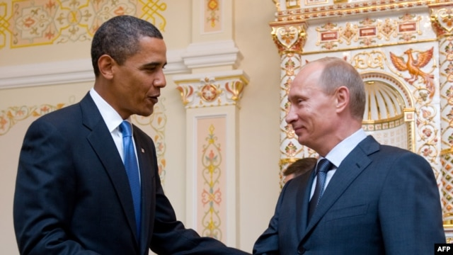Russia -- US President Barack Obama and Russian Prime Minister Vladimir Putin shake hands during a meeting at the latter's country residence home in Novo Ogaryovo, near Moscow, on 07Jul2009.