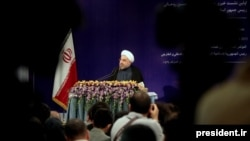 Iran's Hassan Rohani at his first press conference as president on August 6