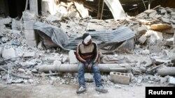 Дамаск түбіндегі көтерілісшілер бақылауындағы аудандарды бірі, Сирия (Көрнекі сурет).