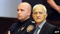 Dragan Vasiljkovic (right) looks on prior to the trial in Split on September 20.