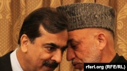 Afghan President Hamid Karzai (right) speaks with Pakistani Prime Minister Yousaf Raza Gilani in Kabul in April