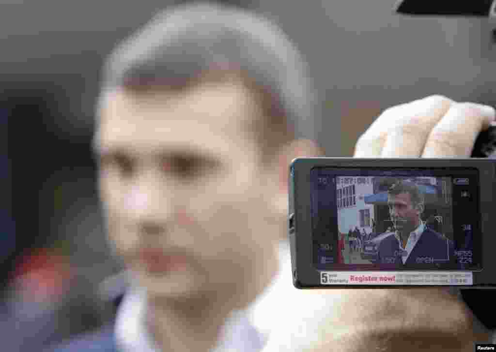 Former international soccer great Andriy Shevchenko, now a member of the pro-business Ukraine Forward! party, is seen on the monitor of a video camera while talking to the media on election day. (REUTERS/Vasily Fedosenko)