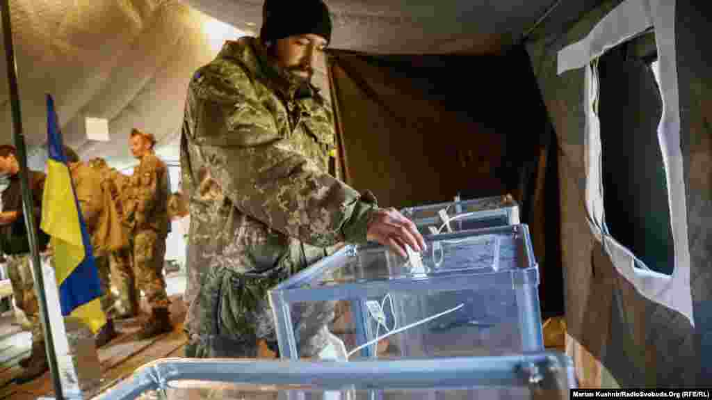 A Ukrainian soldier casts his ballot paper. The choice is between incumbent President Petro Poroshenko and political outsider Volodymyr Zelenskiy.