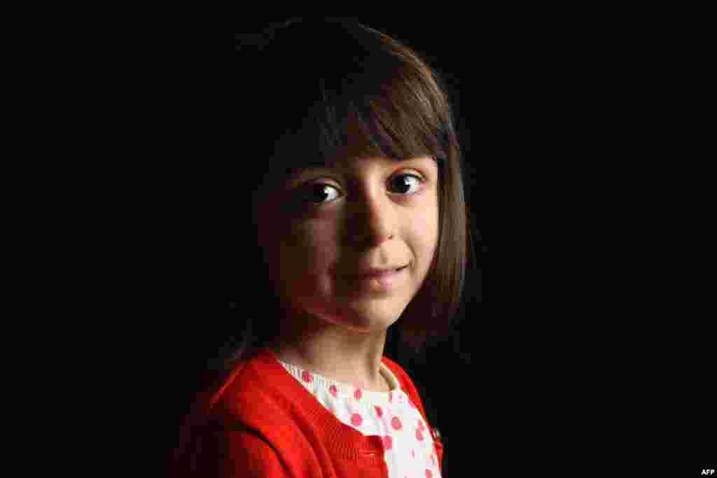Olivia Braddock, 4, was born in Armenia.