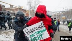 Protestatar reținut la Moscova, 31 ianuarie 2021.