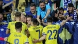 Kosovar players celebrate with fans after their second goal in a match against Bulgaria in June. Kosovo won 3-2.