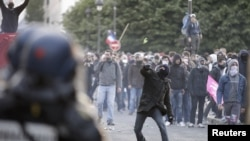 Youths clash with riot police during incidents at the end of a protest march against France's legalization of same-sex marriage.