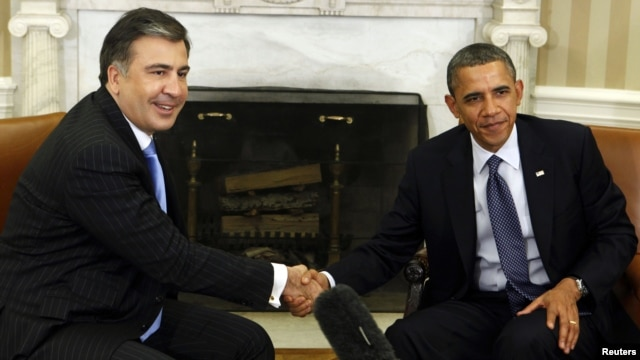 U.S. President Barack Obama (right) welcomes his Georgian counterpart, Mikheil Saakashvili, to the White House on January 30.