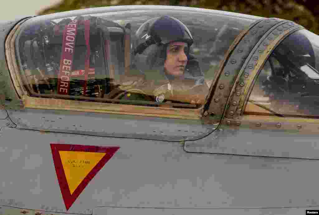 Ayesha Farooq sits in the cockpit of a Chinese-made F-7PG fighter jet at Mushaf base in Sargodha