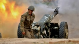 An ethnic Armenian soldier firing artillery toward Azerbaijani positions during fighting over the Nagorno-Karabakh region on September 28.