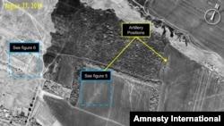 27 августта төшерелгән бу фотода Украинаның сепаратистлар контролендәге өлешендә артиллерия янында хәрби машиналарның артуы күренә