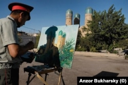 A policeman paints Bukhara's Chor Minor in 2010.