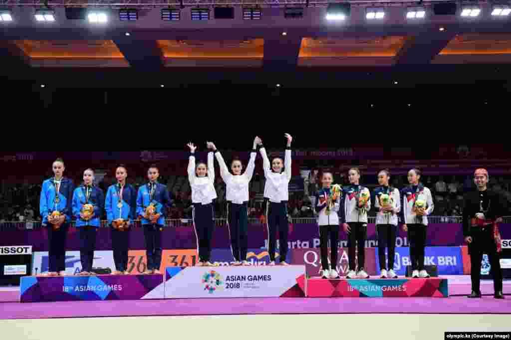Лучшими были казахстанские гимнастки и в командных соревнованиях. Алина Адильханова, Адиля Тилекенова, Даяна Абдирбекова стали чемпионками Азиатских игр. 27 августа 2018 года.
