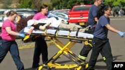 Authorities move a shooting victim after a gunman opened fire at Umpqua Community College in a shooting that killed nine people in Roseburg, Oregon, on October 1.