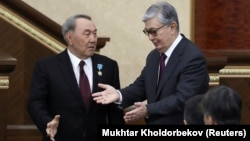 Acting Kazakh President Qasym-Zhomart Toqaev (right) and his predecessor, Nursultan Nazarbaev, attend a joint session of parliament in Astana on March 20.