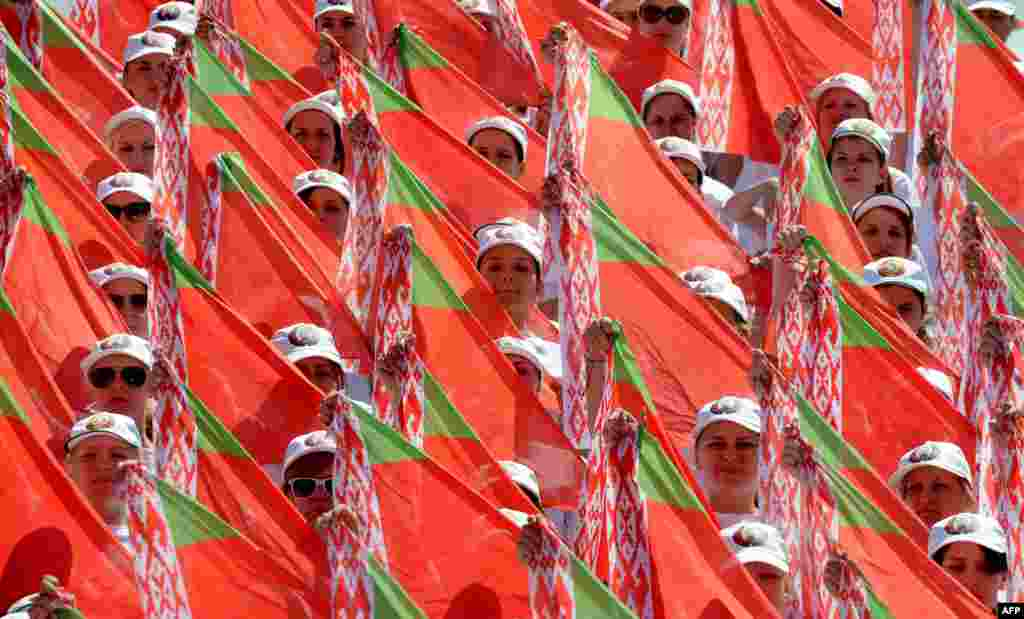 Belarusian teenagers take part in a rehearsal for the upcoming Independence Day parade in Minsk. (AFP/Viktor Drachev)
