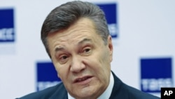 Ukraine's ousted president, Viktor Yanukovych, speaks at a news conference in Rostov-on-Don, Russia.