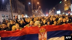 Serbians celebrate in the center of Belgrade after the national tennis team won the Davis Cup finals against France.