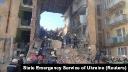Members of the emergency services work at the site of the suspected gas explosion in the town of Drohobych on August 28.