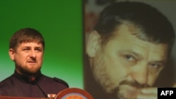 Chechen leader Ramzan Kadyrov in front of a portrait of his father Akhmad Kadyrov, who was assassinated in 2004.