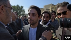 "Ahmad Masud (C), the son of Ahmad Shah Massoud, the largely revered late military and political Afghan leader also known as ""The Lion of Panjshir"" greets supporters during an event marking the fifteen anniversary of his late father's death."