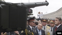 President Viktor Yushchenko (right) inspects military equipment after a parade to celebrate the 18th anniversary of Ukrainian Independence.