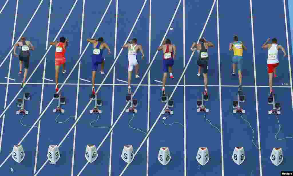 Athletes compete in the men's decathlon 100-meter final.