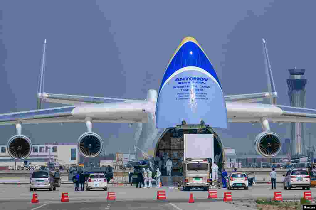 The An-225, which is the world's heaviest plane, being loaded up in Tianjin, China, before a flight to Poland on April 13. The Ukrainian air freighter has become one of the stars of the world's fight against the coronavirus pandemic.
