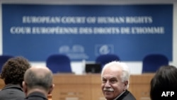 France -- Turkish politician Dogu Perincek from the left-wing Turkish Workers' Party looks on at the European Court of Human Rights in Strasbourg, October 15, 2015