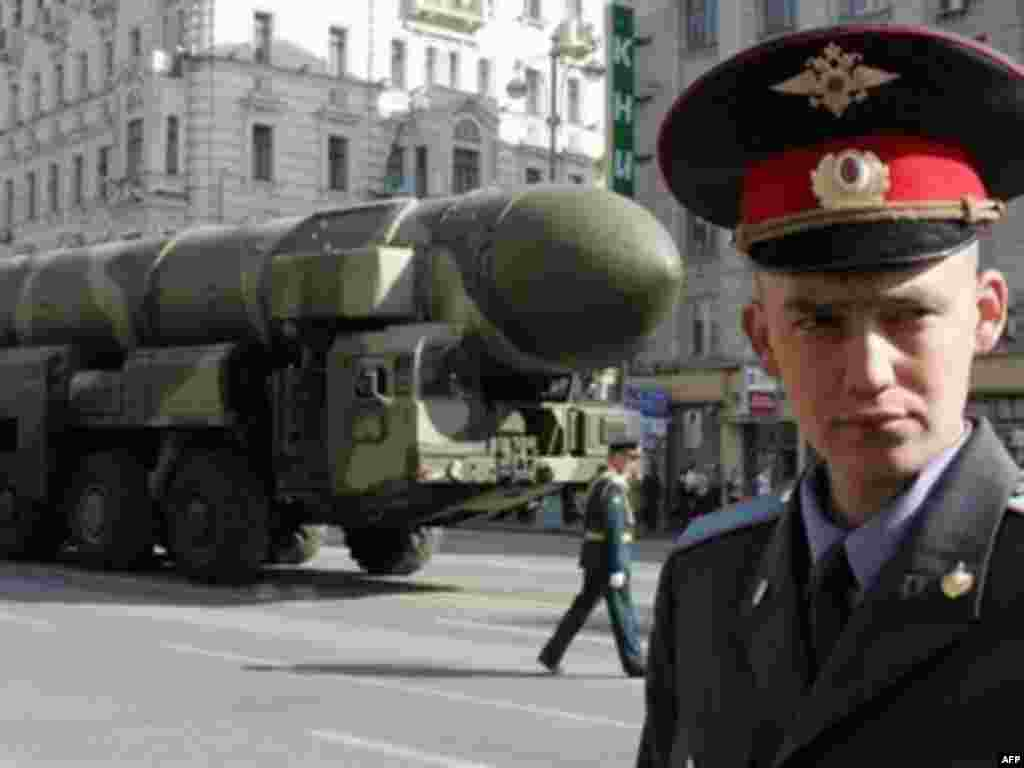 A policeman stands guard in front of a Topol-M - Tanks and weapons, such as the Topol-M intercontinental ballistic missile, will be on display for the Russian public, most of whom grew up in the era of extravagant Soviet military exhibitions.