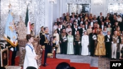 Picture shot 26 October 1967 during the coronation ceremony of Mohammad Reza Pahlavi (L) as Shah of Iran. Prince Reza, a school-age boy stands to the left of his father. Iran's Peacock Throne behind the Shah.