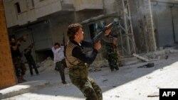 Алеппо қаласында жүріп жатқан ұрыс. Сирия, 13 тамыз 2012 жыл.