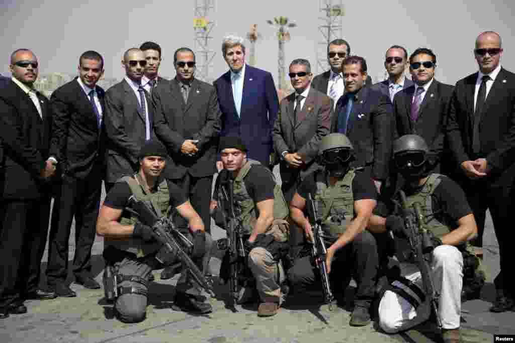 U.S. Secretary of State John Kerry (top row center) poses for a photo with members of his security team in Cairo, Egypt, before boarding a plane for Paris. (Reuters/Carolyn Kaster)
