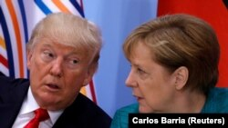 President Donald Trump and German Chancellor Angela Merkel attend the Women's Entrepreneurship Finance event during the G20 leaders summit in Hamburg, Germany July 8, 2017.