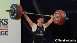 Armenian weightlifter Andranik Karapetian wins a gold medal at the European championships in Norway