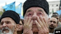 Ukraine/Crimea -- A Crimean Tatar man crying during a mass rally held on the 60th anniversary of the deportation of Tatars from Crimea, Simferopol,18May2004
