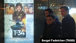 People wait in line to see T-34 at the Formula Kino movie theater in Moscow on January 5.