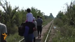 Stream Of Refugees Continues Through Serbia