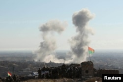Smoke rises from the site of U.S.-led air strikes in the town of Sinjar, November 13, 2015