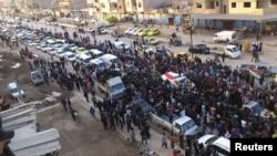 Камышлы қаласында қаза тапқан күрд оппозиционері Насер Алдин Беркахты жерлеуге жиналған демонстранттар. Сирия, 22 ақпан 2012 жыл.