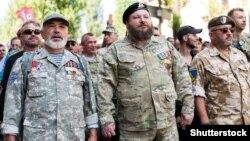 Науковець, учасник війни на Донбасі Євген Дикий (посередині) під час Маршу ветеранів у День Незалежності України. Київ, 24 серпня 2019 року